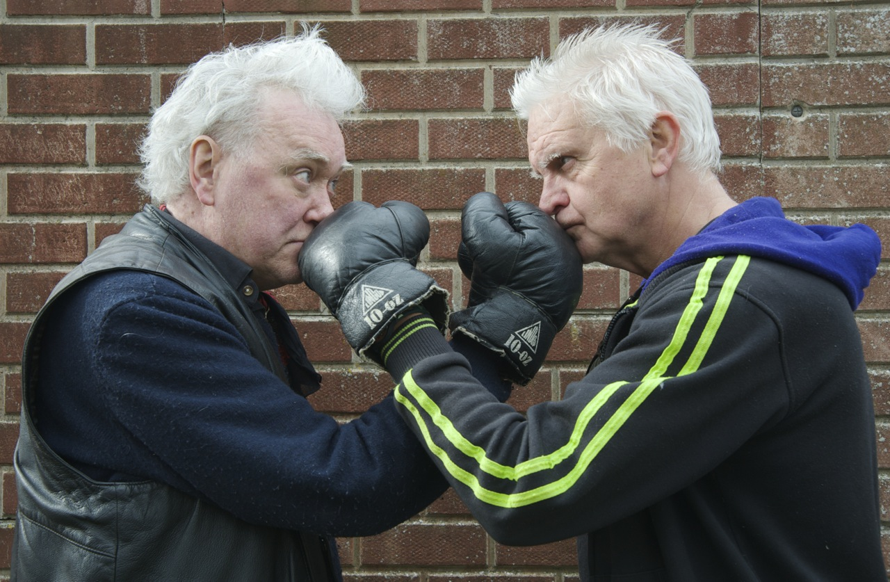 Billy Jenkins and Tony Messenger square up in the boxing ring. Photographed by Beowulf Mayfield