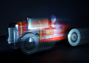 Photograph of toy racing car in motion by Beowulf Mayfield
