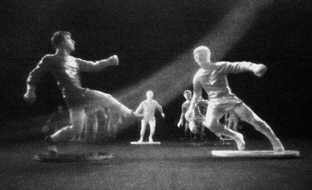 Pinhole image of toy footballers taken by Beowulf Mayfield
