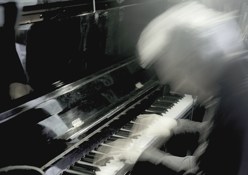 Ghostly image of Billy Jenkins at the piano Photography by Beowulf Mayfield