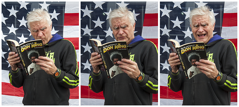 Tony Messenger reading about Don King. Photography by Beowulf Mayfield