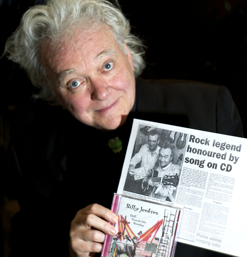 Billy Jenkins with press cutting about Barry Mitchell and Wing Music, photographed by Beowulf Mayfield